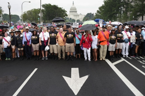 People march from Capitol Hill to the Lincoln Memorial honoring the 50th anniversary of the historic March on Washington (Chip Somodevilla/Getty Images)