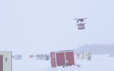 A Lakemaid Beer drone flies a 12 pack to ice fishing shacks in Minnesota.