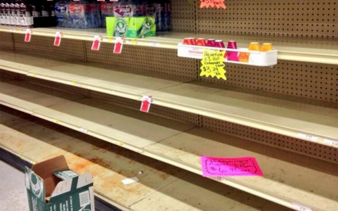 Shelves of water in a Foodland grocery store in Charleston, West Virginia are emptied after water ban notice.