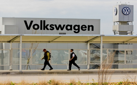 Workers walk by the Volkswagen AG plant in Chattanooga, Tenn.