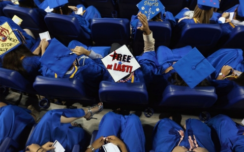 A graduate wears his mortarboard with Free at Last written on it at the commencement ceremony for Cypress Bay High School graduates in 2012 in Miami, Florida.